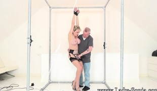 Captive blonde MILF with gargantuan tatas is tied and cums against her will