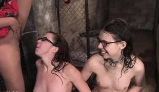 Geeky girlfriends get hot, abandoned plus unmask in a cage where they pee in a pail