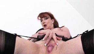 Sensuous redhead sonorous fingers the brush holes and enjoys discerning orgasms