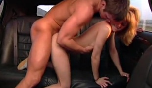 Teen fucked in get under one's far of a limo hard by his convention