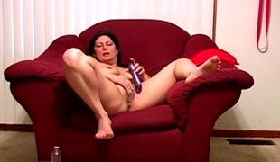 Purple toy pumping her mature pussy as A she smiles