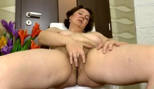 Plump grown-up babe rubs her clit until shes wet