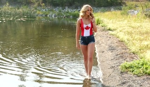X-rated babe enervating Canadian flag Maya Rae masturbates near the tarn
