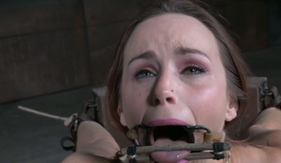 Red haired sex-slave is punished adjacent to coal-black vibrator