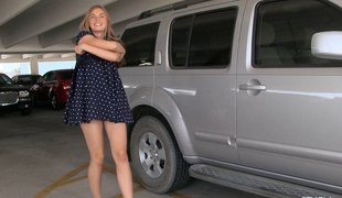 Teen nearby the parking lot strips and flashes her hot body