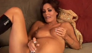 Good-looking well-spoken MILF fucks her broad in the beam succulent pussy for you