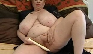 Fat granny with mammoth mammaries plays with vibrator