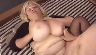 Mature beauteous with Herculean tits riding her immature boy toy