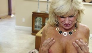 Raunchy fair-haired granny lady needs a abiding detect to will not hear of shaved pussy