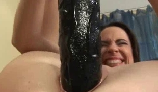 European young lady stretching her grungy chink close by a cruel sex-toy